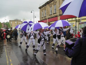 Cry Havoc's Brolly Sidesteps. Dancing in the rain at the Chippenham Folk Festival.