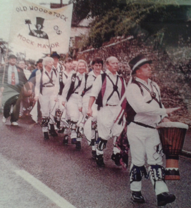 A photograph of Cry Havoc leading the Old Woodstock Mock Mayor procession in an unknown year.