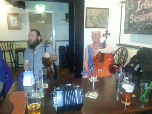 Friday night session at the Harp in Glasbury. Mick and Jane take a break.